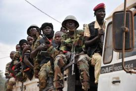 Former Seleka militants sit in a truck as they are escorted out of Kasai military camp in Bangui on January 28, 2014 (AFP, Issouf Sanogo)